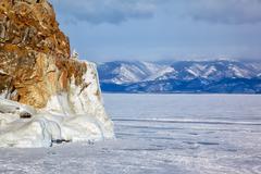 Rocks covered by ice on winter siberian Baikail lake - stock photo