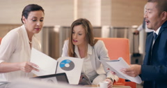 Multi-Ethnic beautiful business women working in business lobby Stock Footage