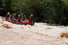 asian people in action at rafting adventure - stock photo