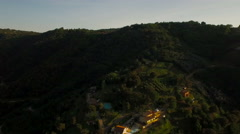 Tanneron Aerial up hillside panning left Stock Footage