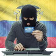 Dark-skinned hacker with flag on background holding credit card - Ecuador - stock photo