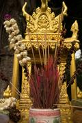 Extreme close up detail of a gold spirit house in Southeast Asia, with guardi - stock photo
