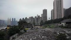 Junkman walking on demolished debris in city center Stock Footage