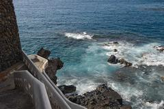 Surf in coastal rocks of Puerto de Santiago, Tenerife, Canary. - stock photo