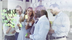 4K Mixed ethnicity business team brainstorming for ideas with sticky notes Stock Footage