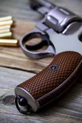Revolver pistol with ammunition Stock Photos