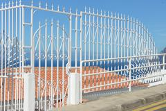 Decorative fence of forged metal in Los Gigantes, Tenerife, Spain. - stock photo