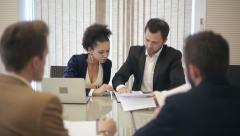 Business team: Business partners meeting. Discussing documents and ideas - stock footage