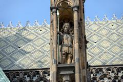 Sculpture in pinnacle of buttress of cathedral St. Vitus, Prague. Stock Photos