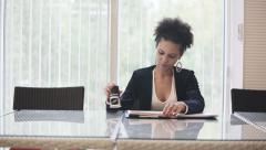 Attractive african american business woman puts a seal on the contract Stock Footage