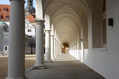 Colonnade of Stallhof toward Chancellery Building and George Gate, Dresden. - stock photo