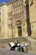 Horse carriage parked next to the mosque of Cordoba. Andalusia, Spain. - stock photo