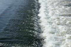 Turbulent foamy stream of river on rapids. Stock Photos