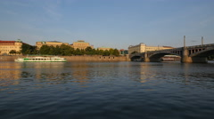 Boat floating on Vltava River near Manes Bridge, Prague Stock Footage