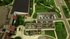 Ypsilanti Aerial low vertical shot over University campus then panning up Stock Footage