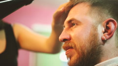Hairdresser dries the hair dryer Stock Footage