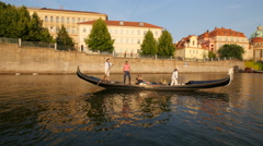 Gondola floating on Vltava River in Prague Stock Footage