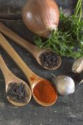 Stock Photo of Various kinds of spices on wooden planks.