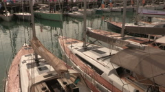 Sailboats moored in the port of the fair  during Genoa Boat Show 2015 Stock Footage