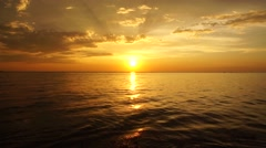 Very beautiful sky stripes in te sky during sundown under a quiet relaxing sea Stock Footage