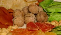 4k – Composition of different dried fruit and nuts on plate 02 Stock Footage