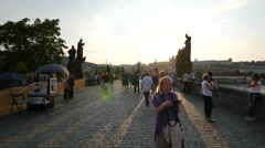 Admiring the statues and the view from Charles Bridge at sunset, Prague Stock Footage