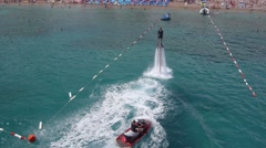 Aerial view on man enjoying water jet pack flyboard at the sea. Stock Footage