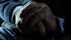 Stock Video Footage of old sad and lonely man: closeup footage on his hands