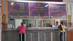 People buying train ticket,Ubon Ratchathani,Thailand Stock Footage