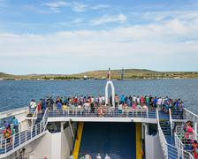 Tourists are on ferry boat in Kerch strait, Russia. Stock Photos