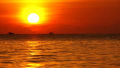 Two ships sailing past and horizon with very beautiful romantic golden sundown Stock Footage