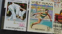 Olympic games - an international stamp collection. Hobby. Philately Stock Footage