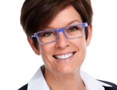 Face of mature business woman with eyeglasses. - stock photo