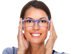 Beautiful young lady wearing eyeglasses. Stock Photos