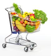 Grocery shopping cart with vegetables and fruits. Kuvituskuvat