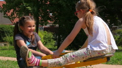 Little girls ride on a swing in the park Stock Footage