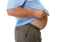 Fat man belly. Stock Photos
