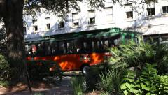 Savannah Georgia tourist trolley in historic district Stock Footage