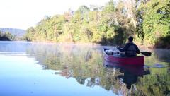 Canoe trip down calm river Stock Footage