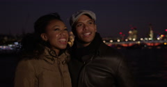 Couple in love on the night against a city backdrop. Shot on RED Epic. Stock Footage