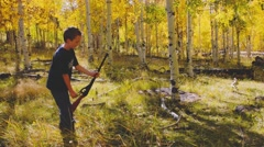 A boy shooting his bb gun while camping Stock Footage