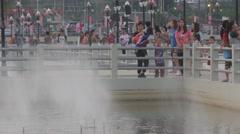 People looking at fountain in Huai Wang Nong,Ubon Ratchathani,Thailand Stock Footage