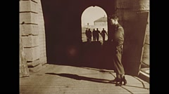 Vintage 16mm film, 1953, soldiers leave fort, soldier checks ID - stock footage