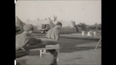 CCC carry beds away past tents 1936 Stock Footage