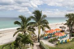 Green beach chairs and blue summer beach house, Florida - stock photo