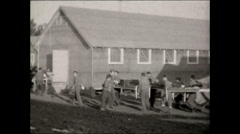 CCC carry beds to buildings 1936 Stock Footage