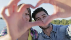 Couple in love making a heart Stock Footage