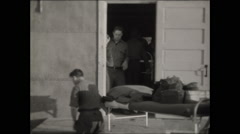 CCC carry beds into building 1936 Stock Footage