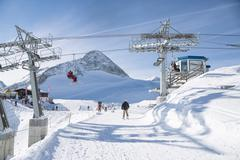 Hintertux Glacier with gondolas, ski runs and pistes in Ziilertal Alps - stock photo