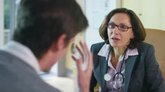 4K Friendly doctor talking to upset or depressed patient in office - stock footage